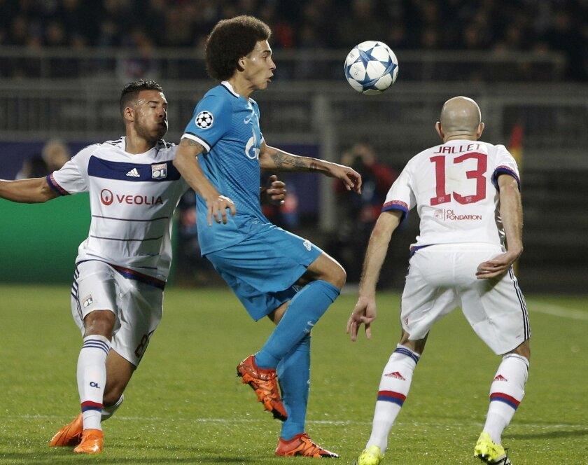Zenit's Axel Witsel, center, controls the ball as he challenges with Lyon's Christophe Jallet, right, during the Champions League Group H soccer match between Lyon and Zenit St Petersburg at the Gerland stadium in Lyon, central France, Wednesday, Nov. 4, 2015. (AP Photo/Laurent Cipriani)