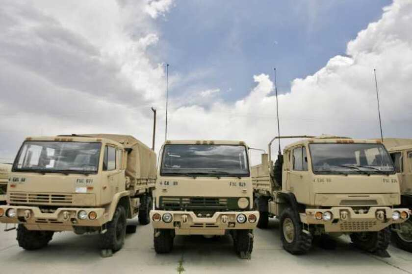 Military trucks lined up at Ft. Carson, where Mike Corley was recently discharged as a first lieutenant.