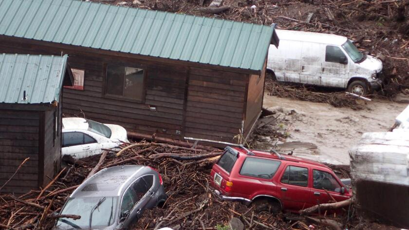 Flood waters and a debris flow sweep away cabins and vehicles at El Capitan Canyon Resort & Campground in Santa Barbara County Friday.