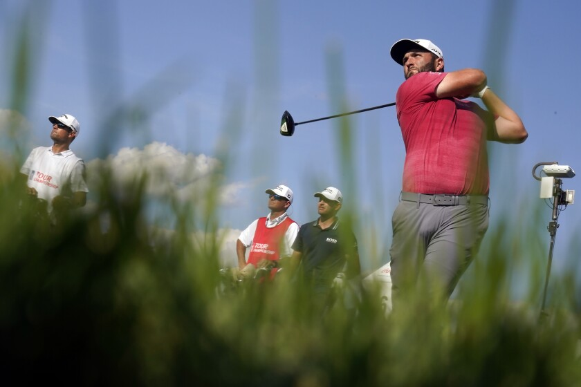 Jon Rahm hits from the 16th tee during the final round of play in the Tour Championship golf tournament at East Lake Golf Club, Sunday, Sept. 5, 2021, in Atlanta. Rahm finished in second place behind Patrick Cantlay. (AP Photo/Brynn Anderson)