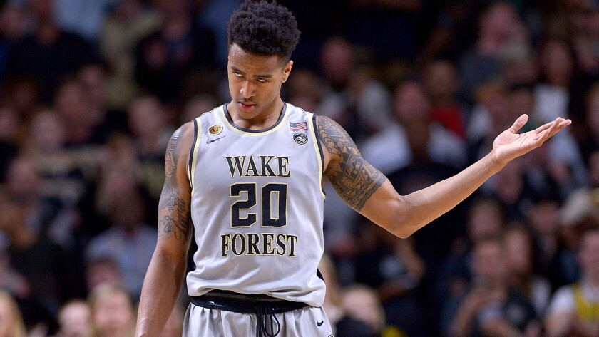 John Collins plays to the Wake Forest fans in the final seconds of an upset of Louisville on Wednesday night.