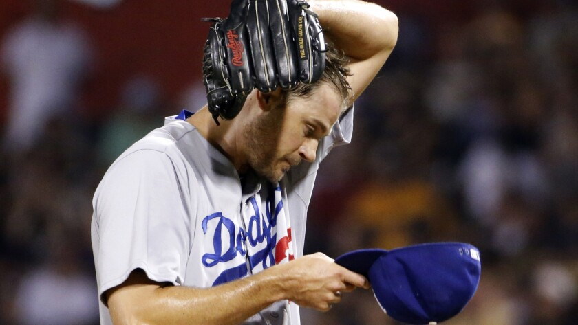 Dodgers reliever Jamey Wright tries to maintain his composure during the sixth inning of Tuesday's game against the Pittsburgh Pirates.