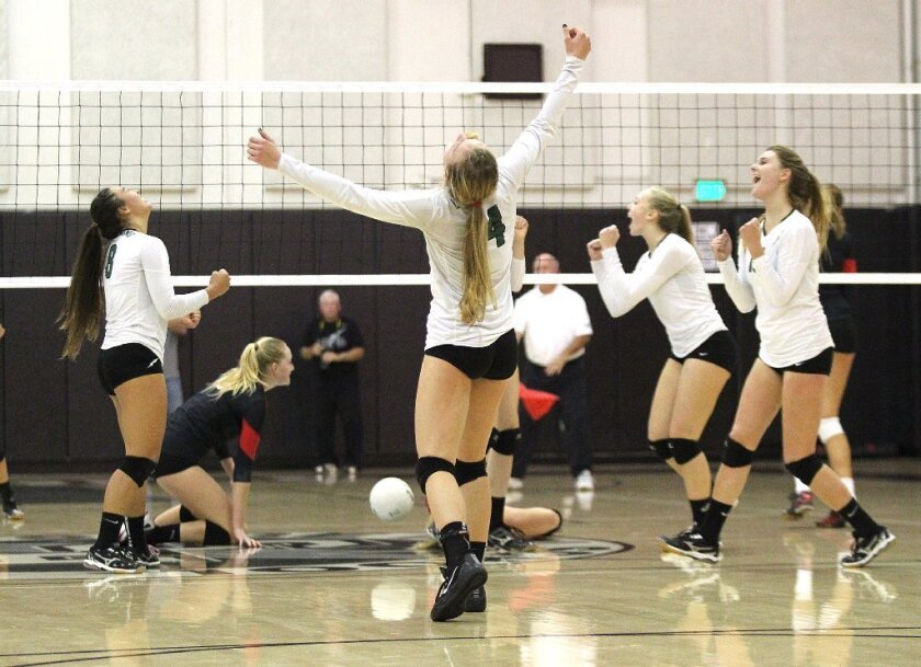 The Sage Hill School girls' volleyball team celebrates after winning a point against La Jolla.