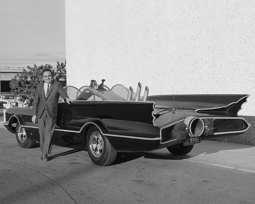 This 1966 photo provided by Lozzi Media Services and Barris Kustom Industries shows designer George Barris with the original Batmobile in Los Angeles. Barris, who created television's original Batmobile, along with scores of other beautifully customized, instantly recognizable vehicles that helped