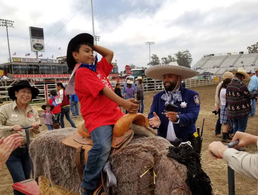 Salinas Police Officer Robert Hernandez in a charro outfit at the rodeo