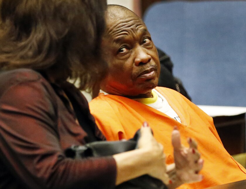 Lonnie Franklin Jr., the alleged Grim Sleeper serial killer, listens to one of his attorneys, Louisa Pensanti, during a pretrial hearing on Aug. 17, 2015.