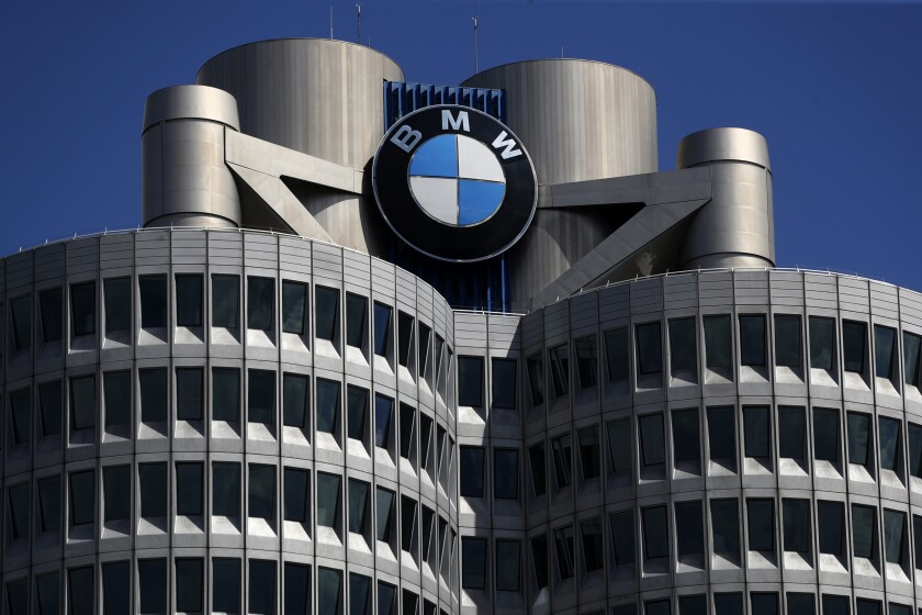 FILE - In this Friday, May 14, 2021 file photo the logo of German car manufacturer BMW is fixed at the headquarters in Munich, Germany. German automaker BMW reports second-quarter earnings on Tuesday Aug. 3, 2021. (AP Photo/Matthias Schrader, file)
