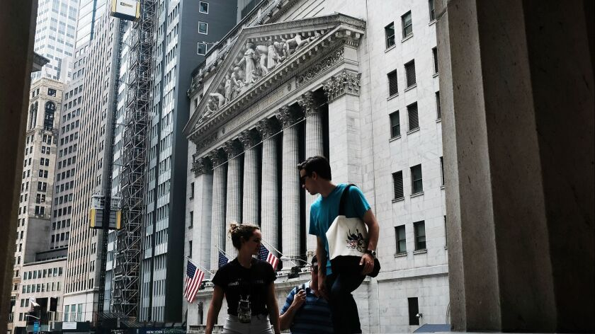 The Dow Jones industrial average fell 144.23 points, or 0.6%, to 25,306.83 on Monday, Above, the New York Stock Exchange.
