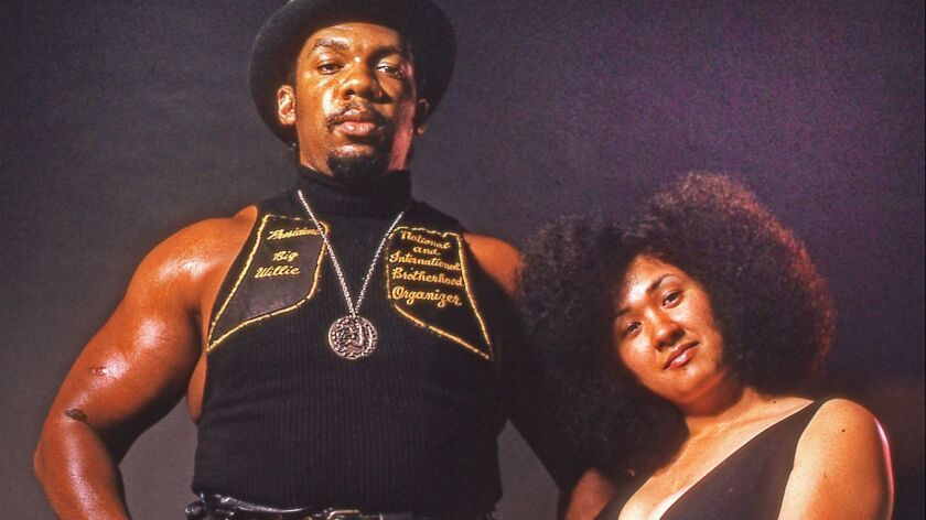 Big Willie Robinson, president of the International Brotherhood of Street Racers and his wife Tomiko
