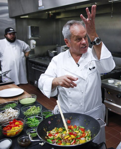 Wolfgang Puck addresses his assistant for the day, Los Angeles Times staff writer John Horn, while preparing dishes from the menu for the 2013 Academy Awards Governors Ball.