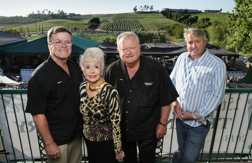 Sally and John Thornton, middle, with their son Steve Thornton, left, and concert promoter Scott Pedersen, at right, at the Thornton Winery