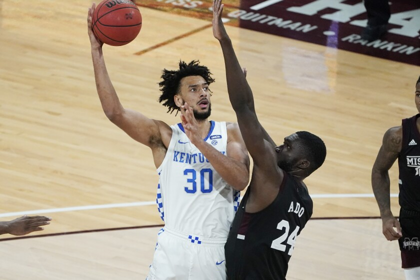 Kentucky forward Olivier Sarr (30) hooks a shot over Mississippi State forward Abdul Ado (24) during the second half of an NCAA college basketball game in Starkville, Miss., Saturday, Jan. 2, 2021. (AP Photo/Rogelio V. Solis)