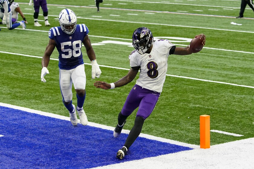 Baltimore Ravens quarterback Lamar Jackson (8) runs in for a touchdown in front of Indianapolis Colts inside linebacker Bobby Okereke (58) in the second half of an NFL football game in Indianapolis, Sunday, Nov. 8, 2020. (AP Photo/AJ Mast)