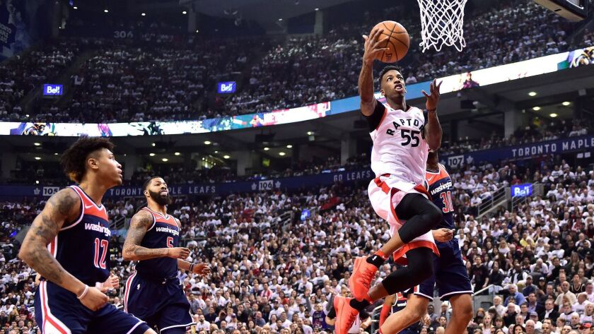 Toronto Raptors guard Delon Wright (55) shoots against the Washington Wizards during the first half