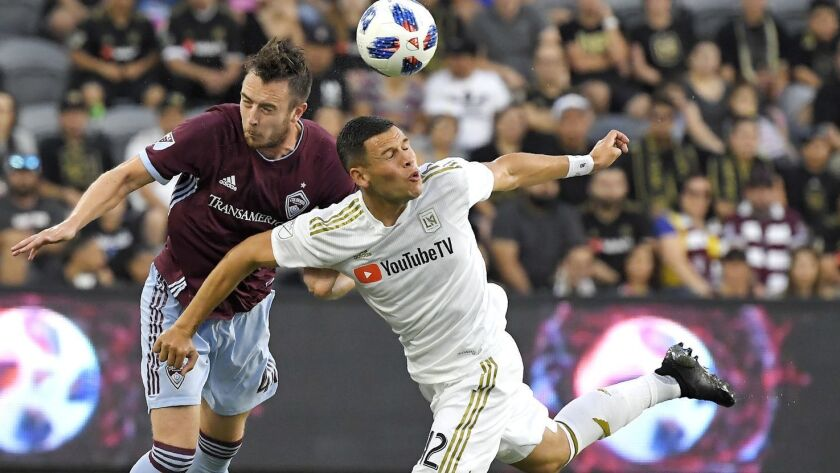 Colorado Rapids defender Danny Wilson, left, and Los Angeles FC forward Christian Ramirez vie for the ball during a match in August.