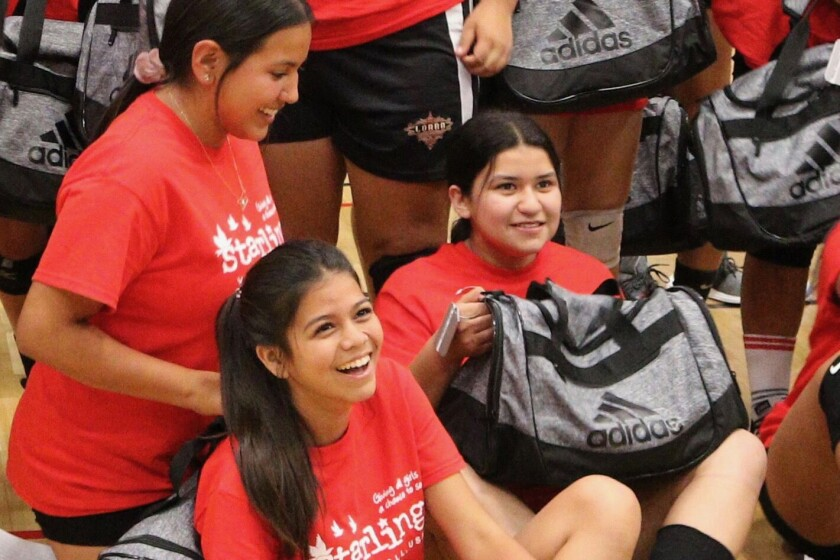 At a recent clinic, girls receive gear from Adidas, a Starlings backer.