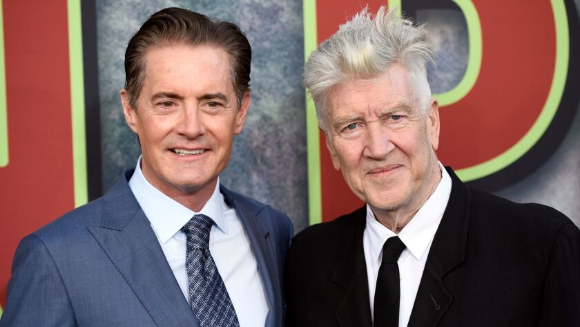 """David Lynch, right, the co-creator, director and executive producer of """"Twin Peaks,"""" poses with star Kyle MacLachlan at the premiere of the Showtime series at the Theatre at Ace Hotel in Los Angeles."""