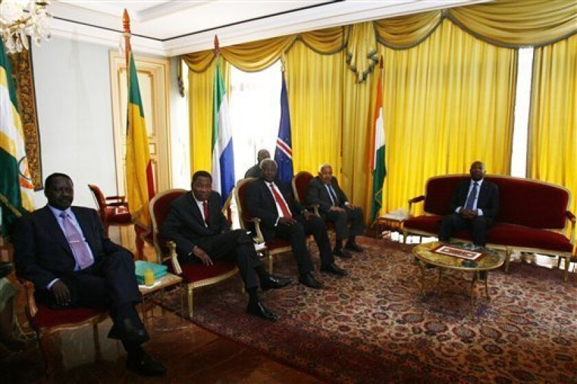 Kenya's Prime Minister Raila Odinga, left, Benin President, Boni Yayi, second left, Sierra Leone's President Ernest Bai Koroma, center, Cape Verde President Pedro Pires and Ivory Coast President Laurent Gbagbo gather before a meeting at the presidential palace in Abidjan, Monday, Jan. 3, 2011. African leaders on Monday were offering Laurent Gbagbo an amnesty deal on condition he cedes the presidency peacefully to the internationally recognized winner of Ivory Coast's elections, an official said Monday. (AP Photo/Sunday Alamba)
