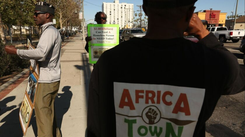 LEIMERT PARK, CA - MAY 16, 2018 - Kevin Wharton Price, left, founder of the Africa Town Coalition, a