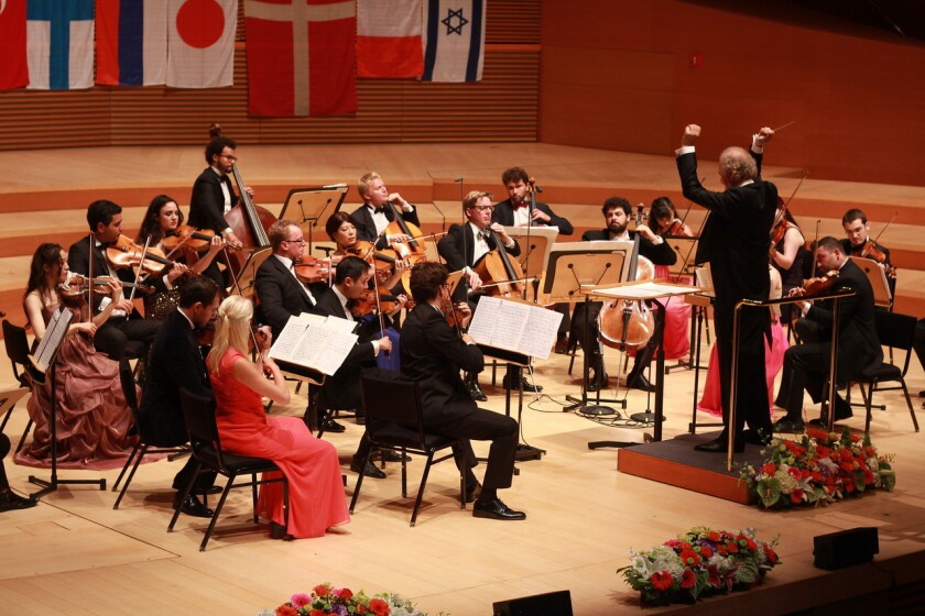 Russian conductor Eduard Schmieder leads the iPalpiti Orchestra of International Laureates in a concert Saturday at Walt Disney Concert Hall.