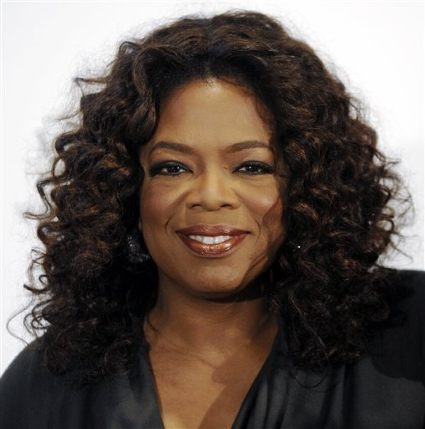 In this Dec. 5, 2008 file photo, Oprah Winfrey arrives at The Hollywood Reporter's annual Women in Entertainment Breakfast in Beverly Hills, Calif. (AP Photo/Chris Pizzello, file)