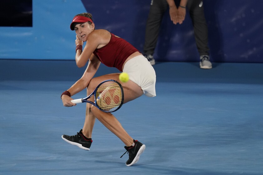 Belinda Bencic, of Switzerland, returns a shot to Marketa Vondrousova, of the Czech Republic, during the women's gold medal match of the tennis competition at the 2020 Summer Olympics, Saturday, July 31, 2021, in Tokyo, Japan. (AP Photo/Seth Wenig)
