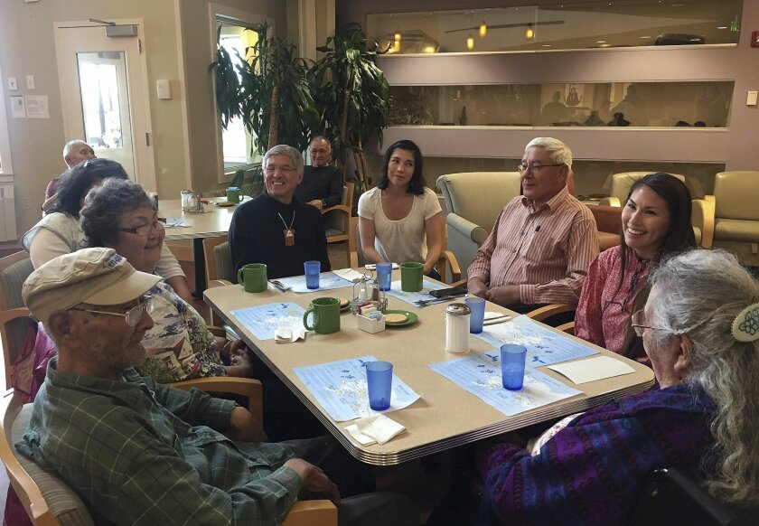 This Sept. 2, 2015 photo released by the U.S. Department of Agriculture shows diners at a long-term senior care facility in Kotzebue, Alaska. Now that the long-term senior care facility in Kotzebue just began incorporating traditional foods into the regular menu, its Alaska Native residents no longer have to just wait for monthly family potlucks to enjoy the taste of the subsistence foods they grew up with. (Sedelta Oosahwee/U.S. Department of Agriculture via AP)