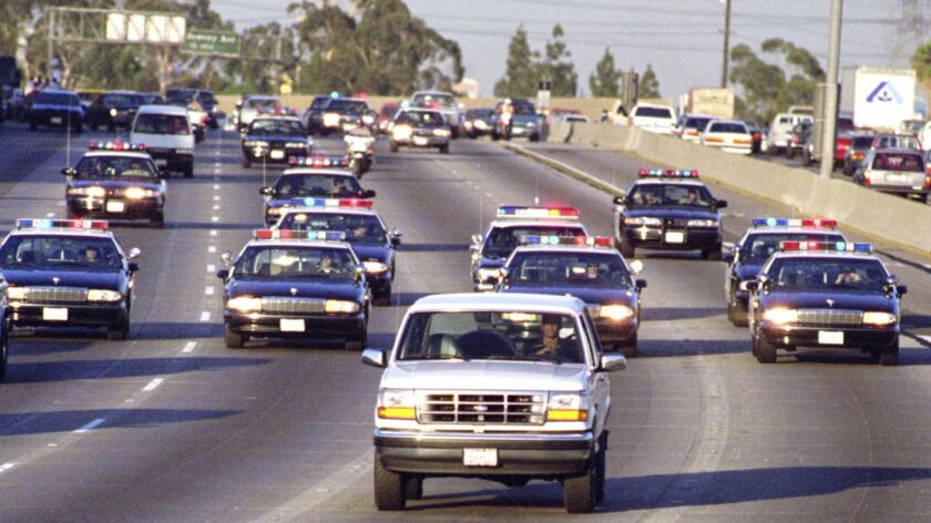 California Highway Patrol on the 91 Freeway chase Al Cowlings, driving, and O.J. Simpson, hiding in