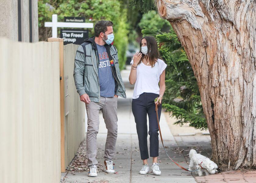Ben Affleck and Ana de Armas walk a dog during the pandemic.