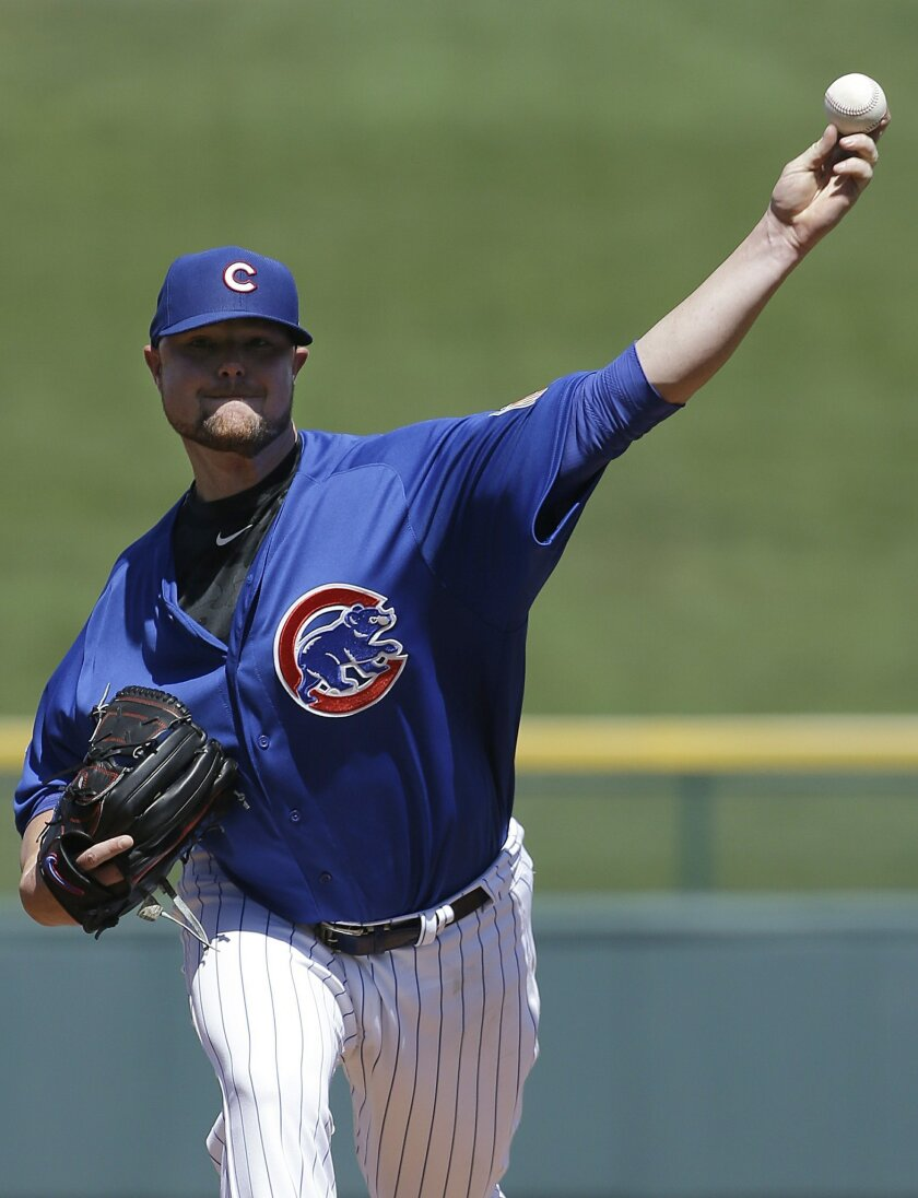 Chicago Cubs starting pitcher Jon Lester throws before the during the first inning of a spring training baseball game against the Milwaukee Brewers in Mesa, Ariz., Friday, March 25, 2016. (AP Photo/Jeff Chiu)