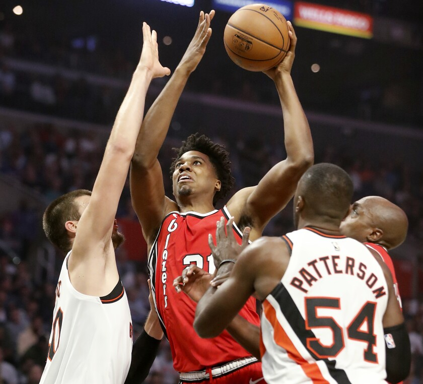 Portland Trail Blazers center Hassan Whiteside goes the basket against Clippers center Ivaca Zubac, left, and forward Patrick Patterson in the second quarter at Staples Center on Wednesday.