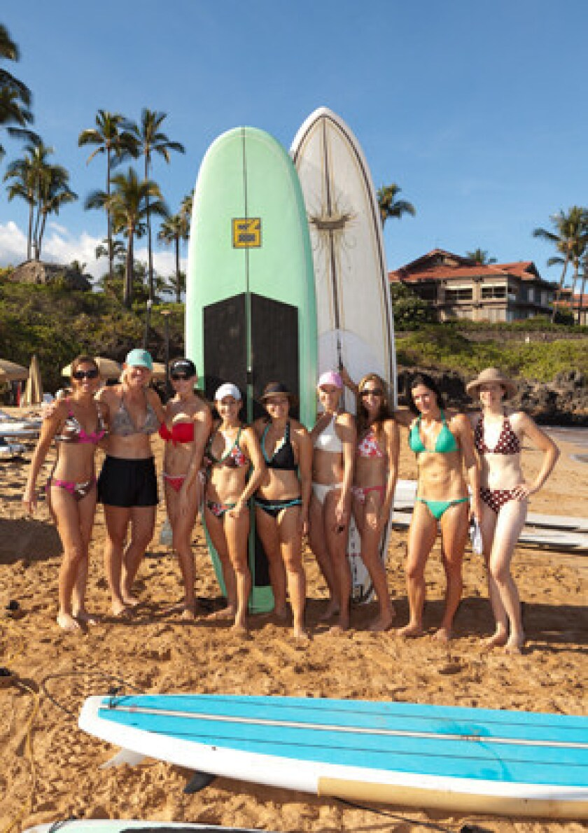 Bride Amy Vavrunek-Fry with her friends and family members at a Four Seasons Maui bridal shower paddleboarding event.