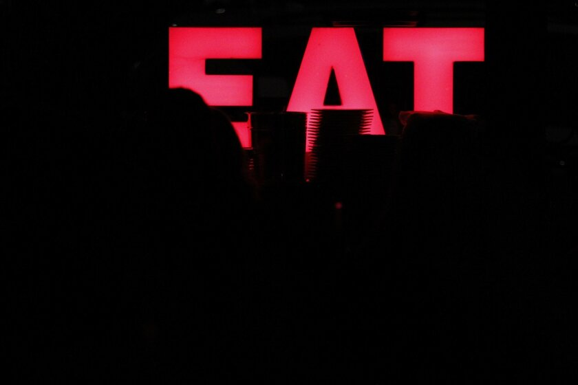 """The """"Eat"""" sign at Searsucker restaurant."""