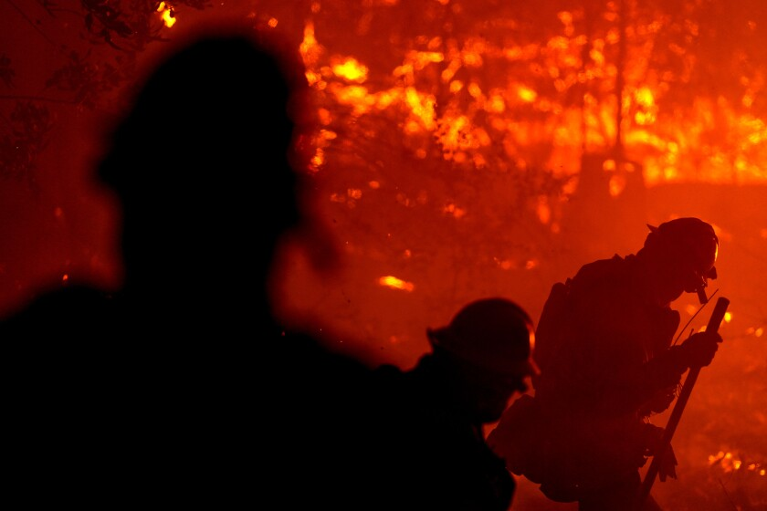 Firefighters perform structure protection against the Glass fire in Napa County.