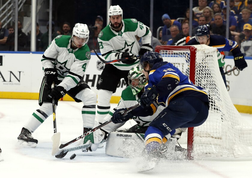 St. Louis Blues' Robert Thomas, right, is unable to score past Dallas Stars goaltender Ben Bishop, M