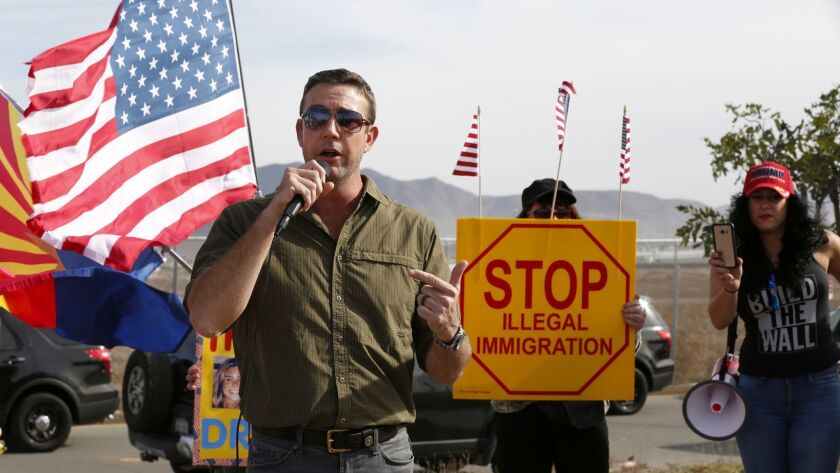 3029622_sd_me_border_wall_rally_NL San Diego, CA December 09, 2017 Duncan Hunter speaks to partici