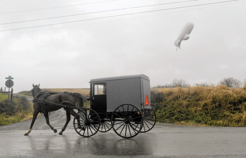 An unmanned Army surveillance blimp that broke loose from its tether at a base in Maryland in October 2015 hovers near Millville, Pa.
