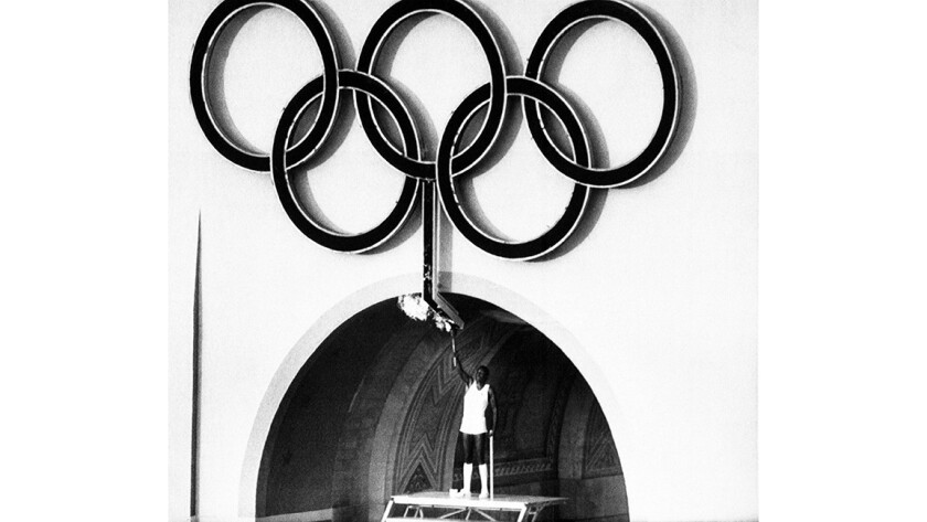 Rafer Johnson lights the torch during the 1984 Olympics opening ceeremony.