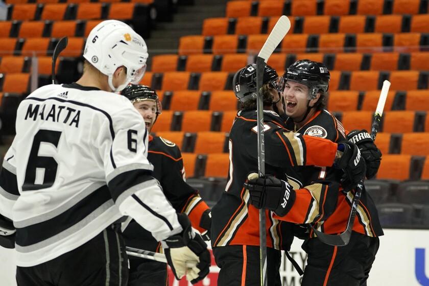 Ducks defenseman Ben Hutton celebrates his goal with center Rickard Rakell as Kings defenseman Olli Maatta stands.