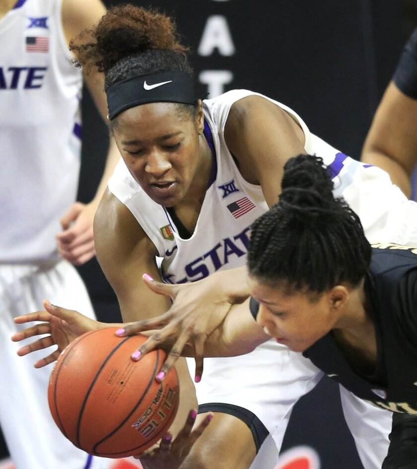 Kansas State forward Breanna Lewis, left, battles for a loose ball with Baylor guard Niya Johnson, right, during the second half of an NCAA college basketball game in Manhattan, Kan., Saturday, Feb. 27, 2016. Baylor defeated Kansas State 63-52. (AP Photo/Orlin Wagner)