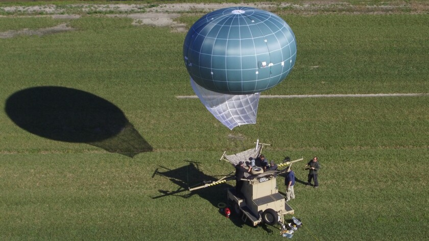 In this undated aerial photo provided by Drone Aviation Corp. shows a tethered balloon, called Winch