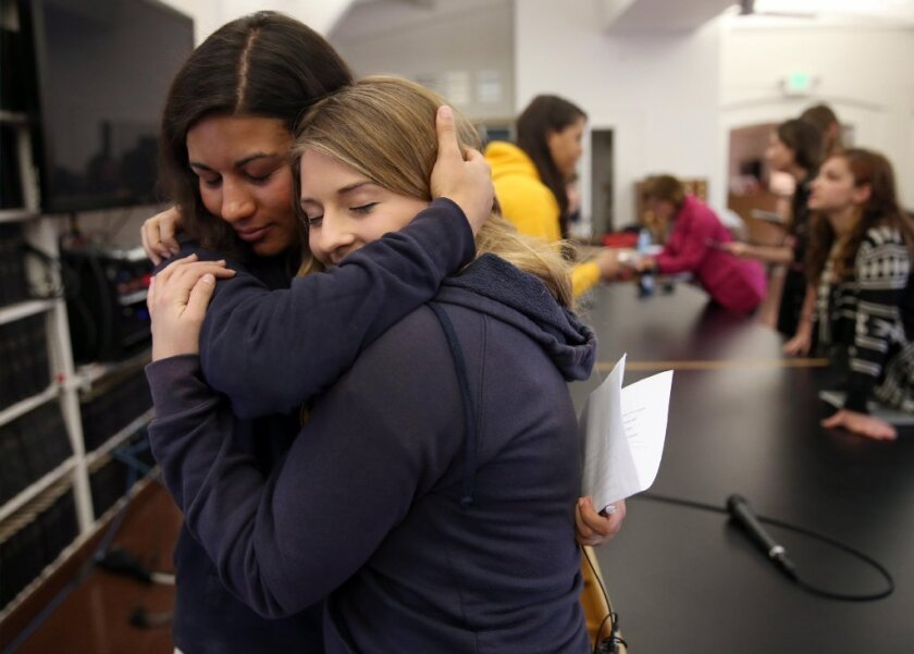 Two UC Berkeley students embrace after speaking at a news conference in February announcing the filing of a federal complaint claiming the university violated federal anti-discrimination laws by failing to protect them against sexual harassment and assault.