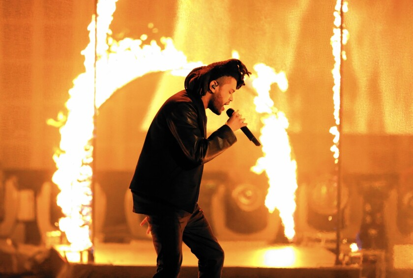 """The Weeknd (Abel Tesfaye), seen performing at the American Music Awards in November, seems even more twisted on """"Beauty Behind the Madness."""""""