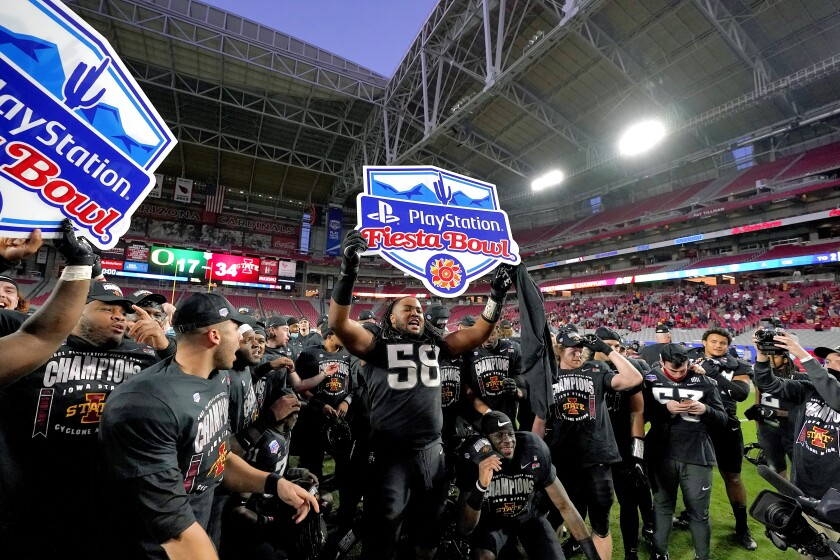 Iowa State players celebrate after the Fiesta Bowl NCAA college football game against Oregon, Saturday, Jan. 2, 2021, in Glendale, Ariz. Iowa State won 34-17. (AP Photo/Ross D. Franklin)