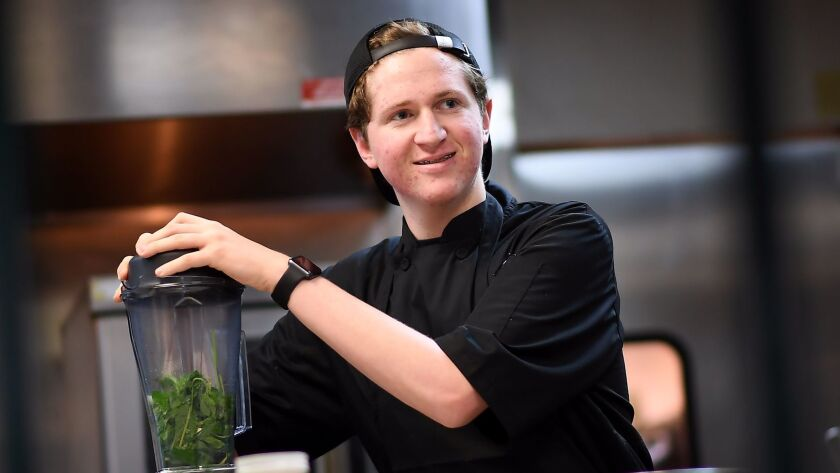 CULVER CITY-CA-AUGUST 2, 2017: Holden Dahlerbruch, 16, works in the kitchen at the Wallace in Culver
