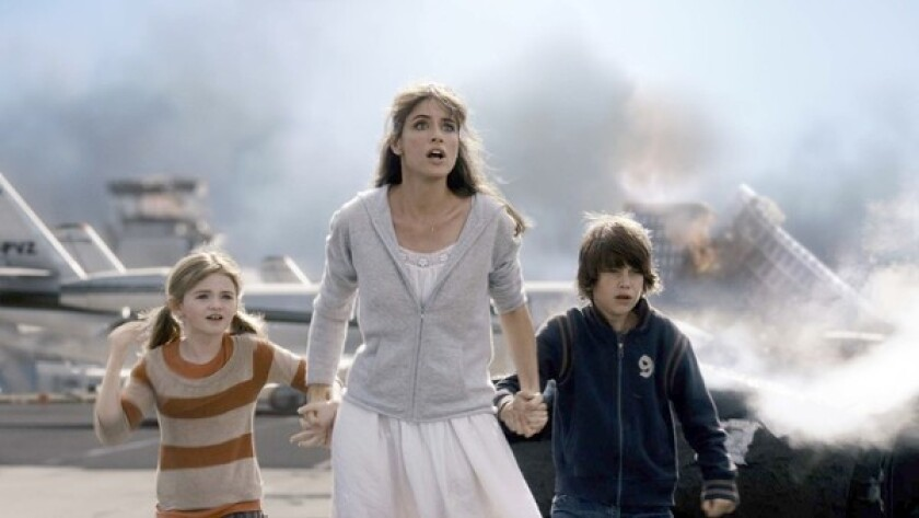 "Amanda Peet, with Morgan Lily and Liam James, stars in ""2012,"" opening next month. The movie's viral marketing campaign has blended seamlessly with websites spreading doomsday theories."