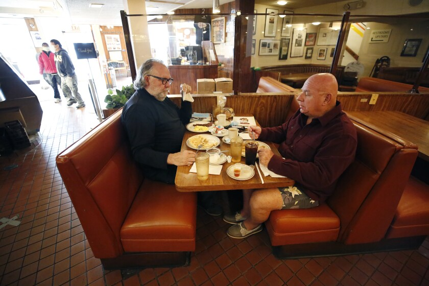 Kelly Cox, left, and Rick Ingold at Canter's Delicatessen.