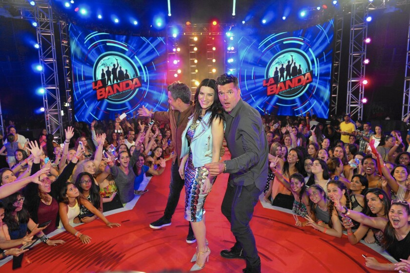 La Banda judges Ricky Martin and Laura Pausini strike a pose on the set with hundreds of screaming fans cheering them on during South Beach auditions.