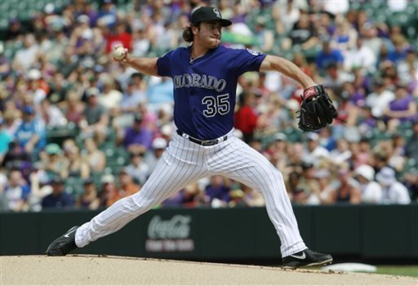 Colorado Rockies starting pitcher Chad Bettis works against the Los Angeles Dodgers in the first inning of a baseball game in Denver on Monday, Sept. 2, 2013. (AP Photo/David Zalubowski)