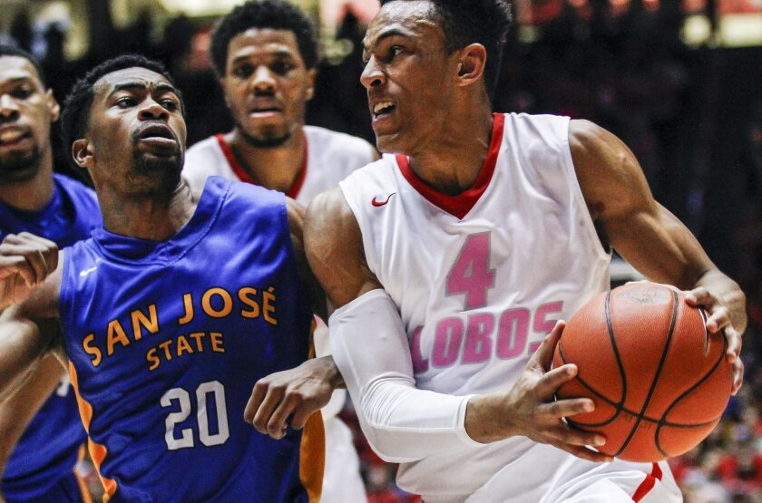 New Mexico's Elijah Brown (4) drives the baseline while guarded by San Jose State's Isaac Thornton (20) during the second half of an NCAA college basketball game, Saturday, Feb. 13, 2016, in Albuquerque, N.M. (AP Photo/Juan Labreche)